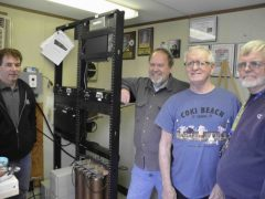 FWRC members pose with the club's new VHF and UHF repeaters at the Clinton Street (Robison Park) location