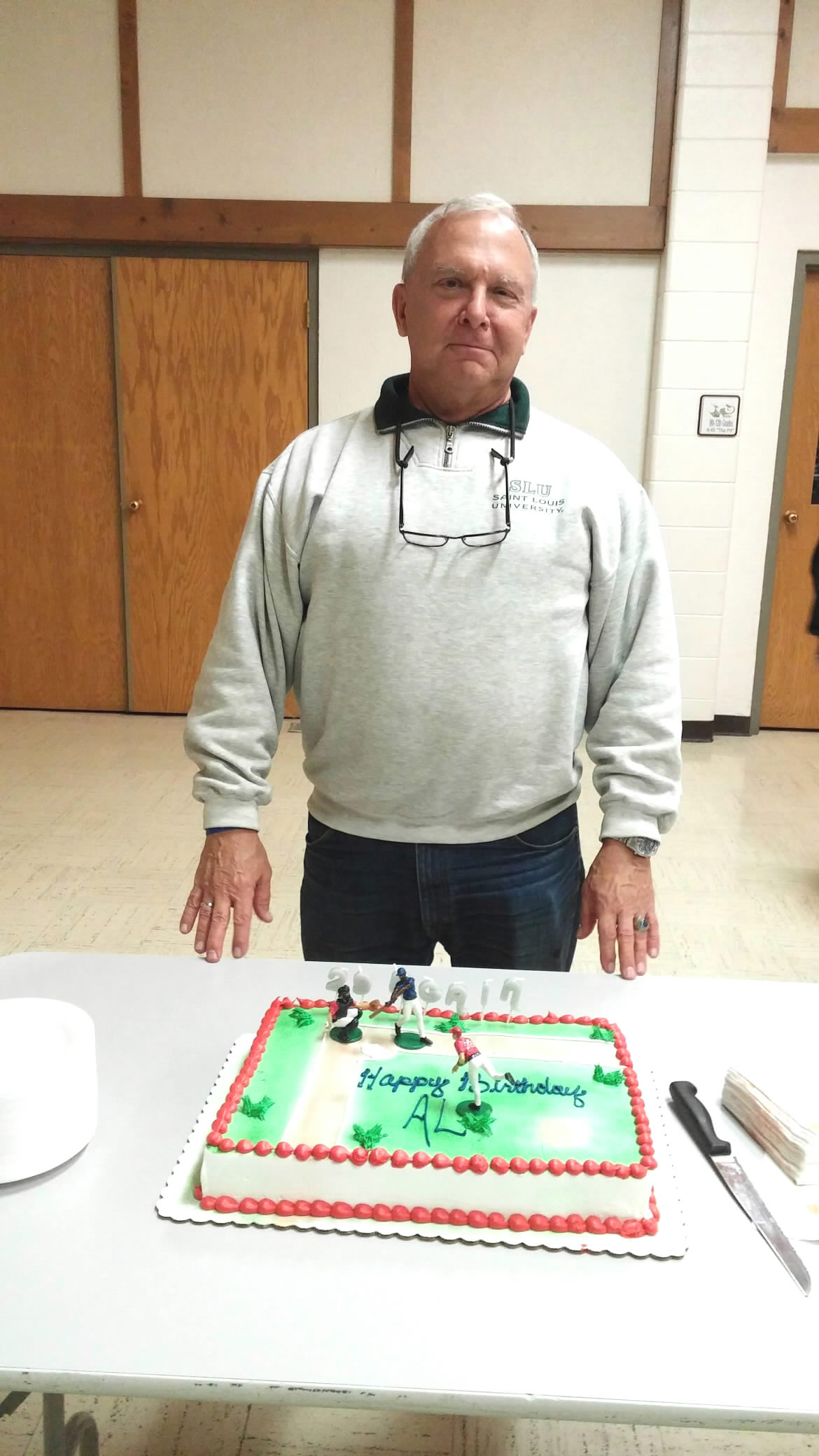 Al Burke, WB9SSE poses with the birthday cake he was presented during the Nov. 2015 FWRC general meeting