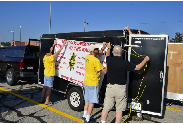 Fort Wayne Radio Club members prepare their exhibit at the annual Safety Fair at Jefferson Pointe shopping center