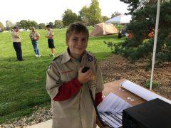 A boy scout communicates via ham radio