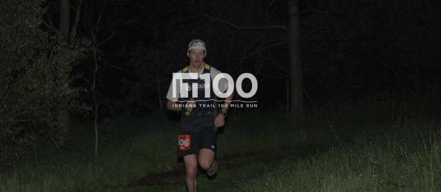 Man running through forest at night
